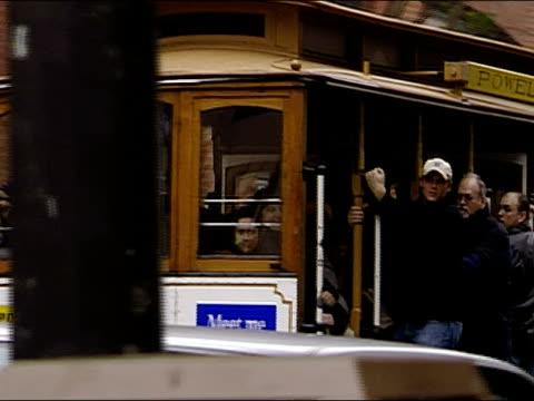 vídeos y material grabado en eventos de stock de medium shot pan people riding street car / san francisco, california - estribo de coche