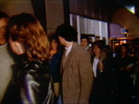 1984 medium shot pan people waiting in line outside movie theater for premiere of 'stop making sense' / audio - line up stock videos and b-roll footage