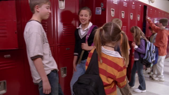 medium shot pan primary school lockers with children opening and closing doors as girl walks by/ goram, maine - locker stock videos & royalty-free footage