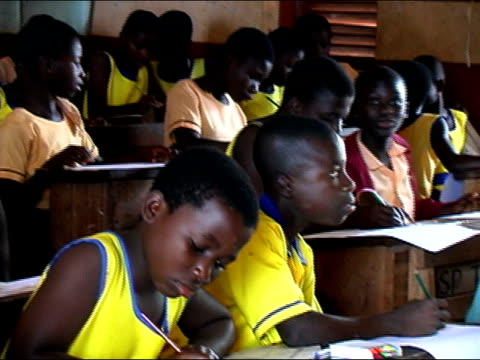 Medium shot pan schoolchildren in classroom/ Ghana