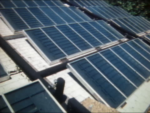 1974 medium shot pan solar panels and water pipes on roof of house / florida / audio - 1974 stock videos & royalty-free footage