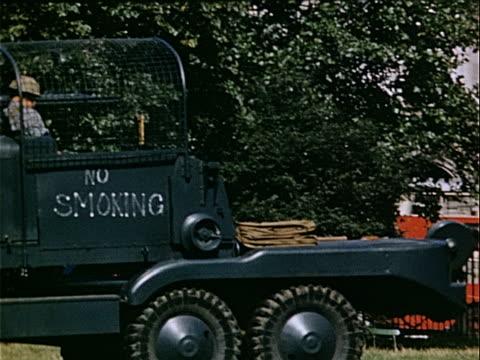 vídeos y material grabado en eventos de stock de medium shot pan soldier sitting in black royal air force truck during war preparations / london england - cultura inglesa