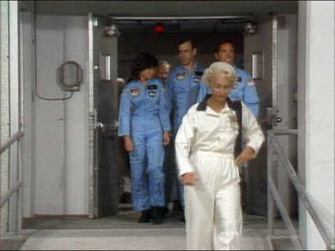 stockvideo's en b-roll-footage met 1983 medium shot pan sts 7 crew including sally ride waving and walking to shuttle / cape canaveral florida - 1983