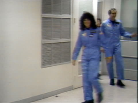 1986 medium shot pan sts51l crew walking into elevator en route to the space shuttle challenger - 1986 stock videos & royalty-free footage