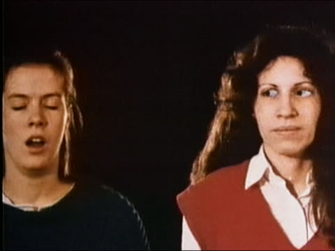 vidéos et rushes de 1987 medium shot pan succession of various people yawning against black background - exhaustion
