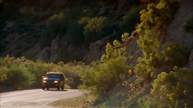 stockvideo's en b-roll-footage met medium shot pan suv driving on winding road / arizona - sports utility vehicle
