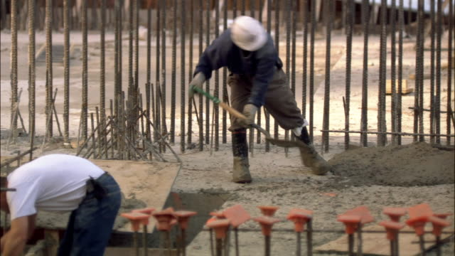 medium shot pan three men working at bryant park construction site/ new york city - gold rush stock videos and b-roll footage