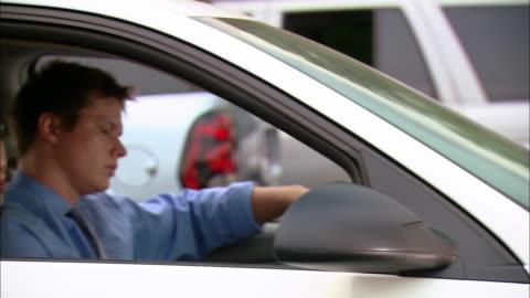 medium shot pan two men and two men carpooling stuck in traffic - traffic jam stock videos & royalty-free footage