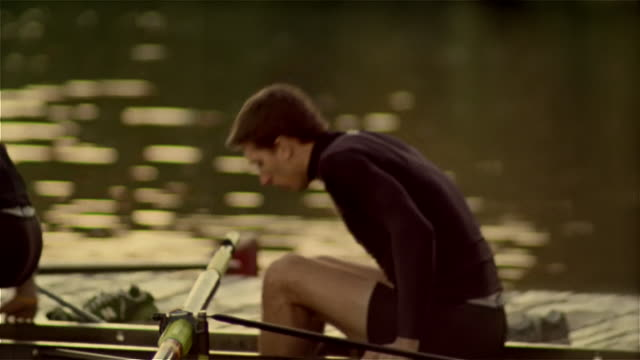 medium shot panning members of rowing team getting into racing shell - scull stock videos & royalty-free footage