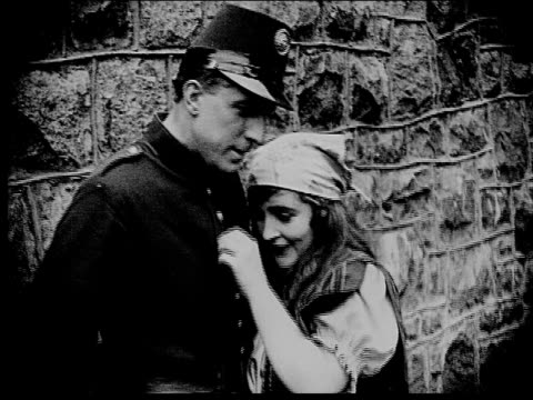 1916 b/w medium shot peasant woman flirting with guard - 1916 stock videos & royalty-free footage