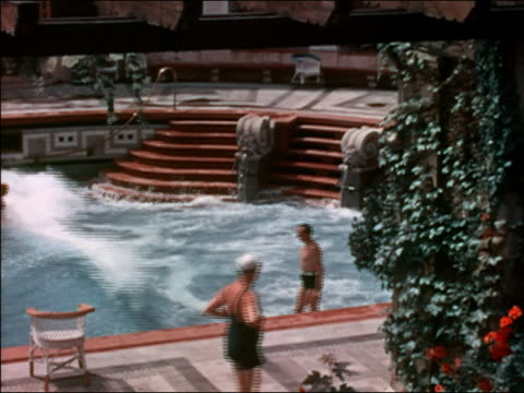1938 medium shot people swimming in wave swimnming pool / budapest, hungary - hungary stock videos & royalty-free footage