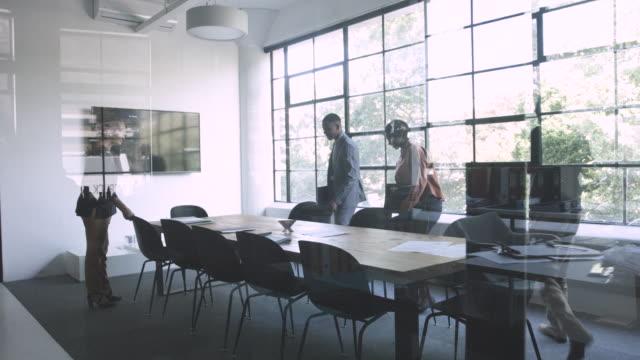medium shot, people walk into business meeting - 30 39 years stock videos & royalty-free footage
