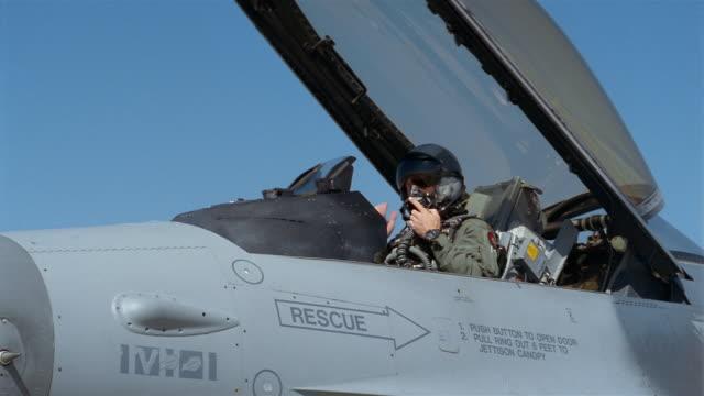 medium shot pilot putting on helmet and closing cockpit of f-16/ denver, colorado - general dynamics f 16 falcon stock videos & royalty-free footage