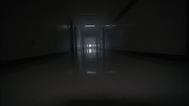 medium shot point of view along hallway of hospital - corridor stock videos & royalty-free footage