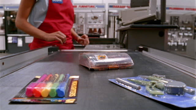 vidéos et rushes de medium shot point of view from items on conveyor belt at megastore/ california - stationary