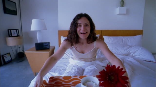 stockvideo's en b-roll-footage met medium shot point of view serving breakfast on tray to woman sitting in bed - dubbel bed