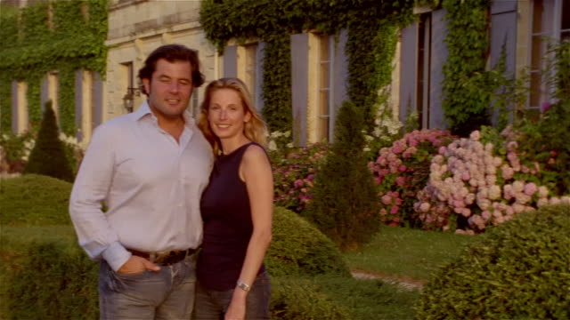 medium shot portrait couple standing outside chateau/ zoom in close up faces/ saint-ferme, france - castle stock videos & royalty-free footage