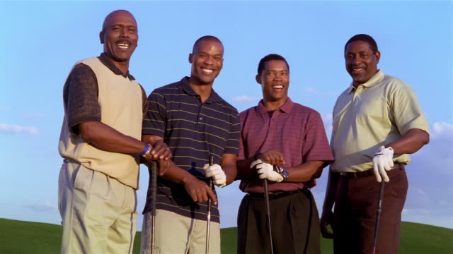 medium shot portrait four men with golf clubs - golf glove stock videos and b-roll footage