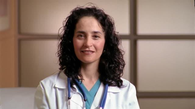 medium shot portrait of doctor smiling at cam / el paso, texas - laboratory coat stock videos & royalty-free footage
