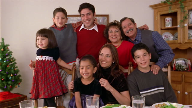medium shot portrait of family gathered at end of dining table - organised group photo stock videos & royalty-free footage