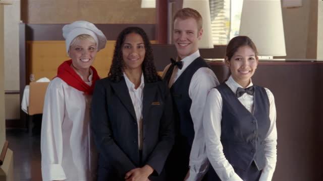 Medium shot portrait of hotel employees smiling at camera