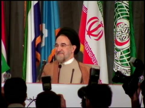 2003 medium shot president khatami of iran smiling as a group of photographers in foreground photographs him - kamera blitzlicht stock-videos und b-roll-filmmaterial
