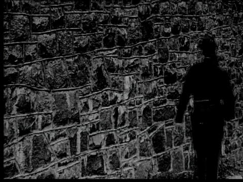 1916 medium shot prison guard marching against wall with rifle - 1916 stock videos & royalty-free footage