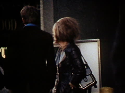 1970 medium shot prostitute talking to man on city street - 1970 stock videos & royalty-free footage