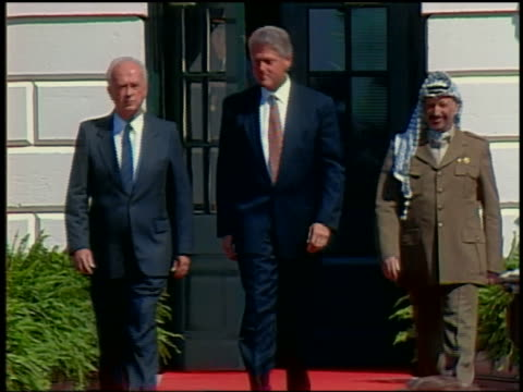 stockvideo's en b-roll-footage met 1993 medium shot rabin clinton and arafat walking out of white house / washington dc - 1993