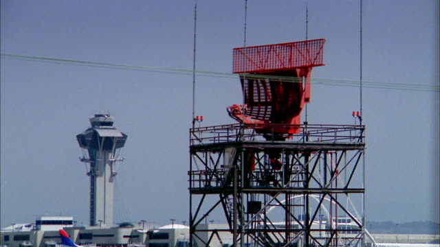 medium shot radar spinning on air traffic control tower and airplane taking off in background / low anglex - lax airport stock videos & royalty-free footage
