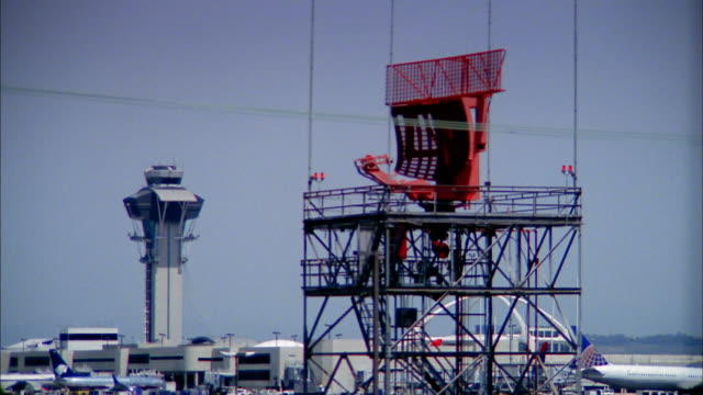 medium shot radar spinning on air traffic control tower and airplane taking off in background / low anglex - air traffic control tower stock videos and b-roll footage