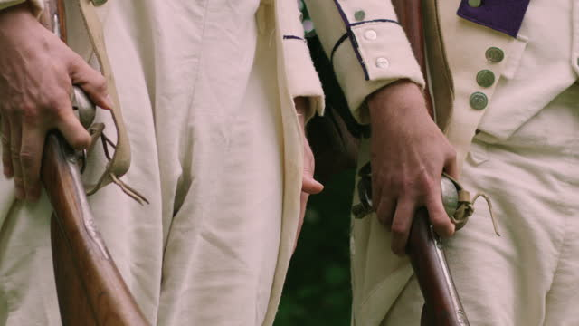 medium shot reenactment of two soldiers holding rifles during the 18th century - military uniform stock videos & royalty-free footage