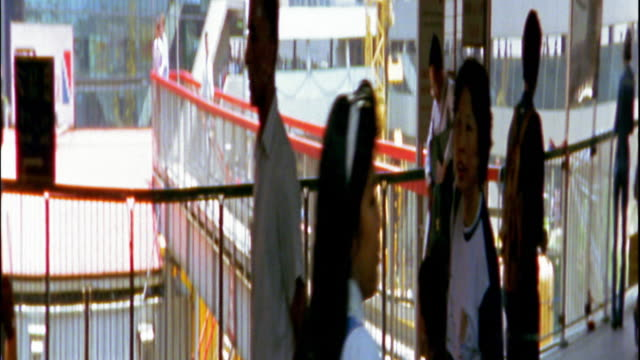 medium shot reflections on mirrored surface of people walking / hong kong - anamorphic stock videos & royalty-free footage