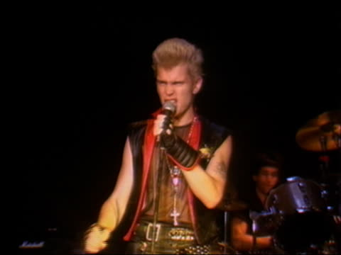 1982 medium shot rock singer billy idol performing on stage w/band / audio - early rock & roll stock videos and b-roll footage