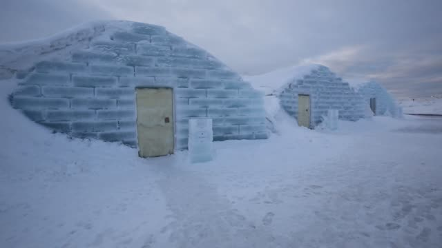 medium shot rooms made from snow and ice at the royce ice hills hotel in tobetsu hokkaido japan on sunday feb 15 wide shot visitors enter a room made... - igloo stock videos & royalty-free footage