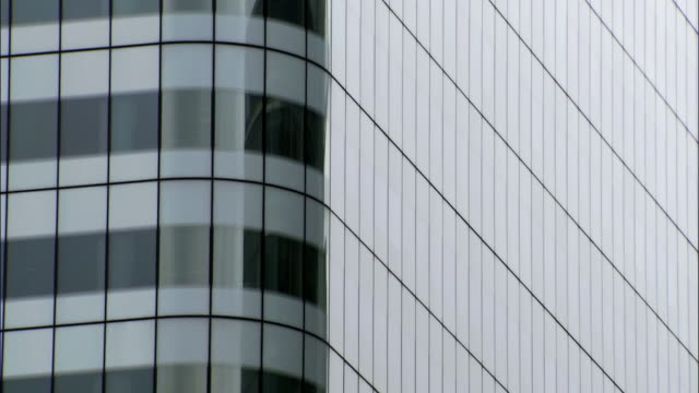 medium shot rounded corner of office building/ tilt up building/ london - two dimensional shape stock videos and b-roll footage