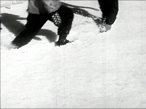 1945 medium shot row of children's feet marching through snow/ audio - mitten stock videos and b-roll footage