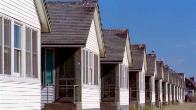 medium shot row of identical beach cottages/ truro, massachusetts - aquatic organism stock videos & royalty-free footage