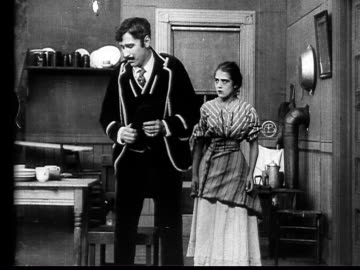 vidéos et rushes de 1910 b/w medium shot salesman flirting with maid in yard by giving her ring  - 1900 1909