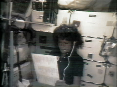 stockvideo's en b-roll-footage met 1983 medium shot sally ride reading off paper into headset microphone aboad the space shuttle challenger - 1983
