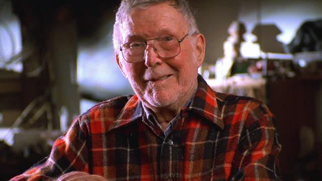 vídeos y material grabado en eventos de stock de medium shot senior man wearing flannel shirt - camisa a cuadros