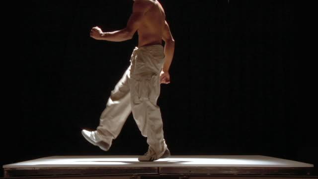 medium shot shirtless man breakdancing - 50 seconds or greater stock videos & royalty-free footage