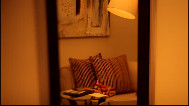 medium shot showing reflection of cushions and lamp in a mirror in a five-star hotel room. - domestic room stock videos & royalty-free footage