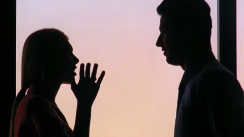 medium shot silhouette of couple talking, arguing and gesturing indoors / lisbon, portugal - boyfriend stock videos & royalty-free footage