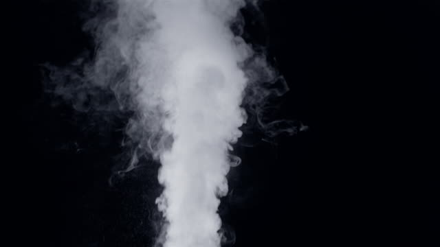 vidéos et rushes de medium shot smoke billowing against black background - fumée