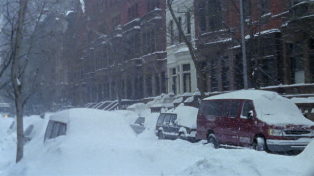2003 medium shot snow falling on Upper West Side street during blizzard / New York City