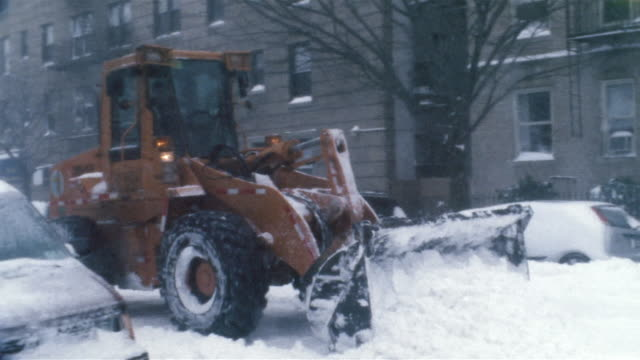 medium shot snow plow clearing streets during snowstorm/ new york city - snowplough stock videos & royalty-free footage
