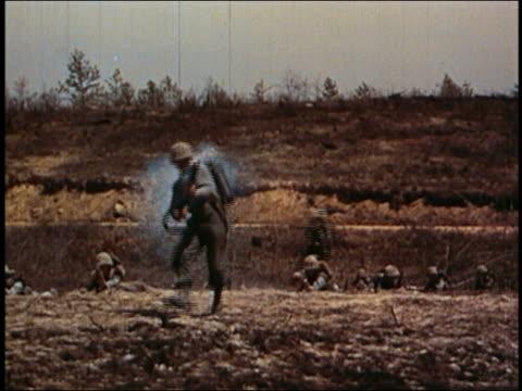 medium shot soldier firing flame thrower at cam / vietnam - guerra del vietnam video stock e b–roll