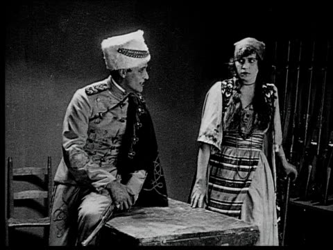 1916 b/w medium shot soldier forcing himself on captured peasant woman - 1916 stock videos & royalty-free footage