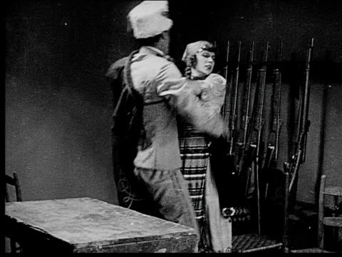 1916 B/W Medium shot soldier forcing himself on captured peasant woman/ woman pushing him away/ woman pushing him away